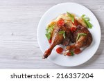 duck legs baked with apples and ... | Shutterstock . vector #216337204