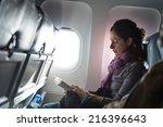 woman reading book inside... | Shutterstock . vector #216396643