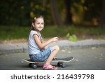 little girl sitting on a... | Shutterstock . vector #216439798