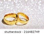 two golden rings on white...   Shutterstock . vector #216482749