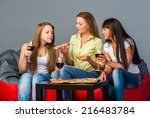 three girls with wine and pizza  | Shutterstock . vector #216483784