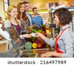 smiling woman paying cash with... | Shutterstock . vector #216497989