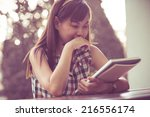 close up of a young girl... | Shutterstock . vector #216556174