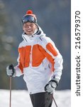 Smiling Skier In Cap And Goggles