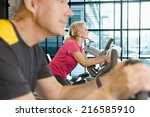 man and woman riding exercise... | Shutterstock . vector #216585910