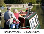 couple hugging on narrow boat...