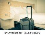 Stock photo prepared fresh bed scene in hotel room horizontal retro toned shot 216595699