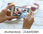 hand making photo of sandwiches ... | Shutterstock . vector #216640384