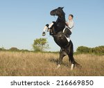 Young Man Riding A Black...