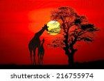 Setting Sun With Silhouettes O...