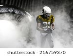 football player  on a yellow... | Shutterstock . vector #216759370