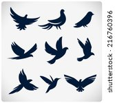 Stock vector set of flying birds sign dark silhouettes isolated on white 216760396