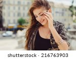 young girl posing in the street | Shutterstock . vector #216763903
