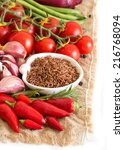 red organic rice in bowl and... | Shutterstock . vector #216768094