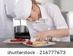 trainee chef wiping plate of... | Shutterstock . vector #216777673