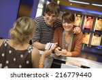 a couple buying movie tickets... | Shutterstock . vector #216779440