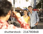a boy taking a photo with his... | Shutterstock . vector #216780868