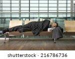 a businessman asleep in airport ... | Shutterstock . vector #216786736