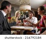 friends at a restaurant.   Shutterstock . vector #216792184