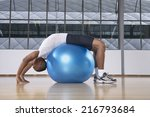 man stretching on a fitness...   Shutterstock . vector #216793684