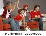 family watching a sports match... | Shutterstock . vector #216805000