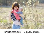 young woman with her little... | Shutterstock . vector #216821008