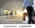 Small photo of Dynamic photo of busy crowd of people walking, blurred motion.