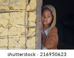 Stock photo madagascar shy and poor african girl with headkerchief 216950623