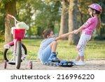 girl in park  helps boy with...   Shutterstock . vector #216996220
