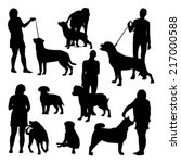 people and dogs silhouettes set | Shutterstock .eps vector #217000588