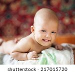 Smiling Baby Lying On His...