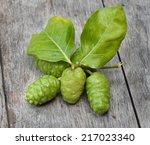 noni fruit on wood | Shutterstock . vector #217023340