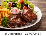 tasty grilled ribs with... | Shutterstock . vector #217073494