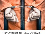 handcuffed hands of a prisoner... | Shutterstock . vector #217094626