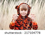 Little Girl Shows A Tiger