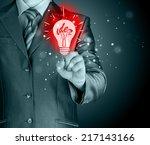 business man touching light of... | Shutterstock . vector #217143166