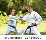 Young Couple Doing Martial Art...