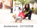 Stock photo woman with dog and shopping bags 217152538