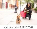 Stock photo woman with dog and shopping bags 217152544