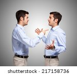 man talking to a clone of... | Shutterstock . vector #217158736