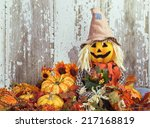 Cute Scarecrow Surrounded By...