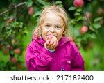 Little Girl Biting Apple In Th...
