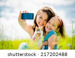 mother taking photo with her... | Shutterstock . vector #217202488