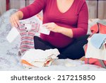 Pregnant Woman Packing Hospita...
