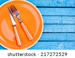 Empty Orange Plate And Fork...