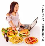 woman eating fast food at work. ... | Shutterstock . vector #217279543
