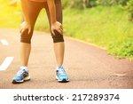 tired woman runner taking a... | Shutterstock . vector #217289374