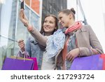 female friends with shopping... | Shutterstock . vector #217293724