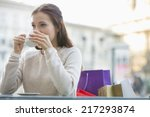 young woman drinking coffee at... | Shutterstock . vector #217293874