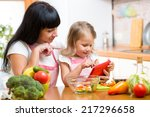 mother and child preparing... | Shutterstock . vector #217296658